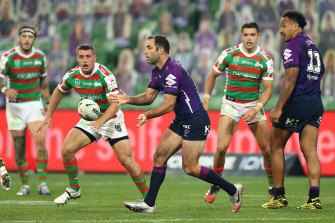 Cameron Smith, centre, passes the ball during the Melbourne Storm's found four clash against South Sydney.