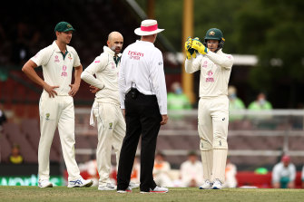 Tim Paine (right) remonstrates with umpire Paul Wilson at the SCG on Friday.