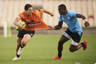 Mark Nawaqaintawse of NSW Country is tackled during the Round 3 NRC match between NSW Country and Fiji Drua at WIN Stadium in 2019.