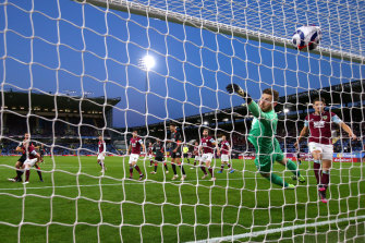 Burnley goalkeeper Will Norris could only watch on as Nathaniel Phillips' header put Liverpool 2-0 up and on course for a Champions League spot.