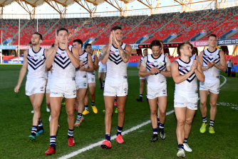 No contest: The Dockers celebrate a 64-point win over North Melbourne.