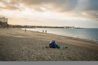 The sun rises over St Kilda beach on New Year's Day.