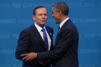 Getting a grip: Tony Abbott, then Prime Minister, welcomes US President Barack Obama to the G20 in Brisbane in 2014.