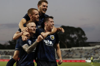 The Mariners celebrate their opening goal against Sydney FC.