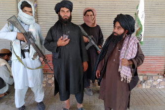 Taliban fighters patrol inside the city of Farah, south-west of Kabul, on Wednesday.
