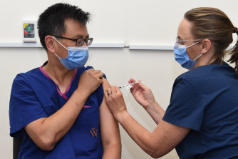 Professor Allen Cheng receives the Pfizer jab at The Alfred hospital on Friday morning.