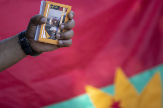 "A member of the Tigrayan-Ethiopian community in Pretoria, South Africa, holds a booklet titled ""Nobel Prize Licence to Kill"" during a protest against the conflict in Ethiopia's Tigray region."