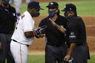 Astros manager Dusty Baker chats with the umpires after the benches cleared.