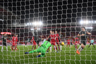 Liverpool goalkeeper Alisson pulls off a sensational save to deny Manchester United talisman Marcus Rashford.