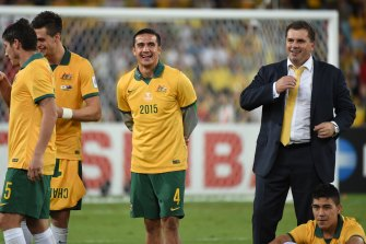 Cahill and Ange Postecoglou celebrate the Socceroos' Asian Cup triumph in 2015.