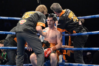 Jeff Horn receives attention from his team during rounds.