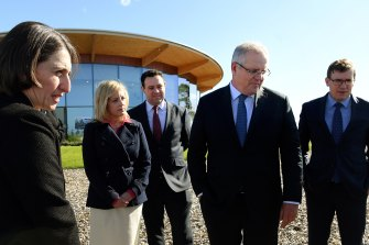Premier Gladys Berejiklian (left) and Prime Minister Scott Morrison (second from right) at the site of the new Western Sydney International Airport.