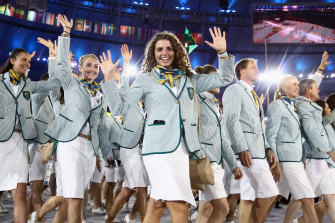 Jessica Fox (centre) walks out with Australian teammates at Rio opening ceremony in 2016.