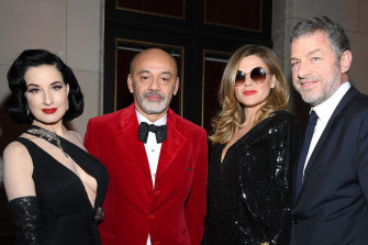 (L to R) Dita von Teese, Christian Louboutin, Melody Gardot and Jacques Bungert at the Musee Des Arts Decoratifs opening in February.