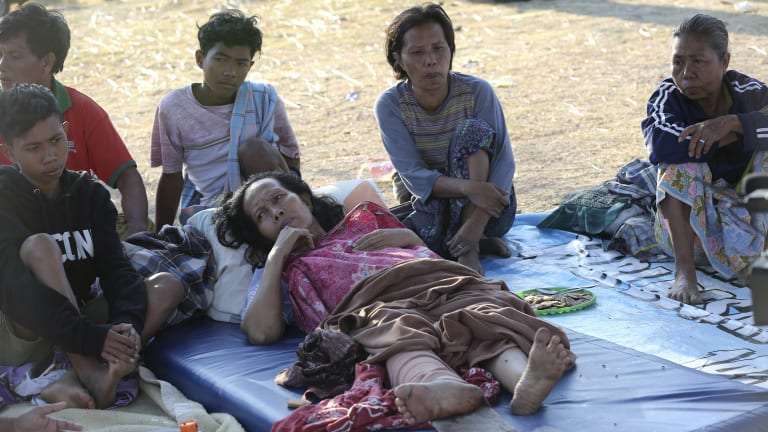 An injured woman lies at a temporary shelter in North Lombok.