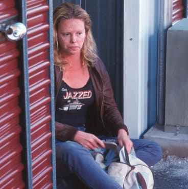 Charlize Theron as serial killer Aileen Wuornos in Monster (2003).
