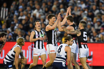 Collingwood celebrate as the Cats are left to rue their missed chances and prepare for a tough match next week.