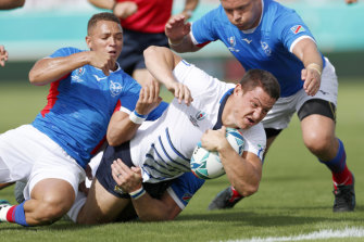 Namibian players bring down Italy's Luca Morisi during their Rugby World Cup Pool B game in Osaka on Sunday.