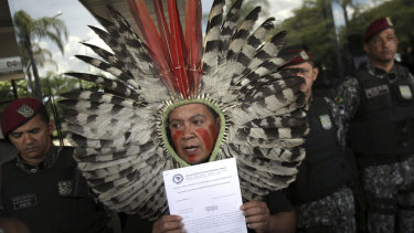 Kaigang Chief Kreta holds a letter of protest outside the transition office of President-elect Jair Bolsonaro, in Brasilia. Indigenous demands include the demarcation of native lands and the protection of the National Indian Foundation.