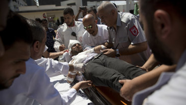 A Palestinian wounded during Monday's protest is brought to a hospital in Gaza City.