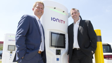 Dr Michael Hajesch, chief executive of IONITY and Dr David Finn, chief executive and co-founder of Tritium with a charging station in Germany.