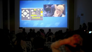 People watch the live broadcast of the SpaceIL spacecraft as it lost contact with Earth.