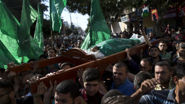 Palestinians carry the body of Mousab Abu Leila, 29, during his funeral after he was killed during Monday's protest on the border with Israel.