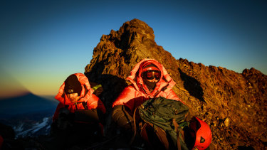 Isabella de la Houssaye, left, and her daughter Bella take a break at sunrise, just a few hours shy of the summit of Argentina's Aconcagua, the highest peak outside the Himalayas.