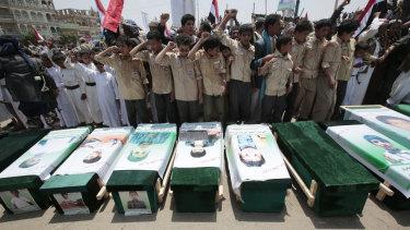 Yemeni people attend the funeral of victims of a Saudi-led airstrike, in Saada, Yemen, in 2018.