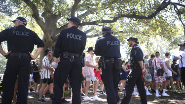 Police patrol outside Field Day at The Domain on New Year's Day.