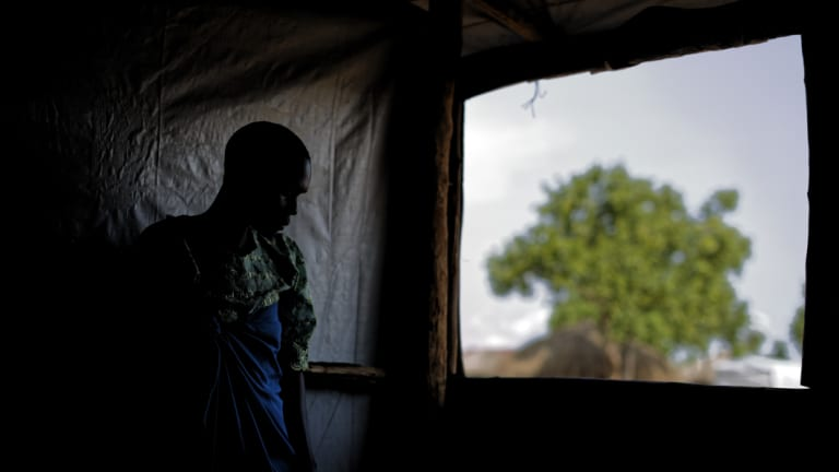 A South Sudanese refugee and 32-year-old mother, who said she was raped for several days by a group of soldiers before she was allowed to leave in 2017.