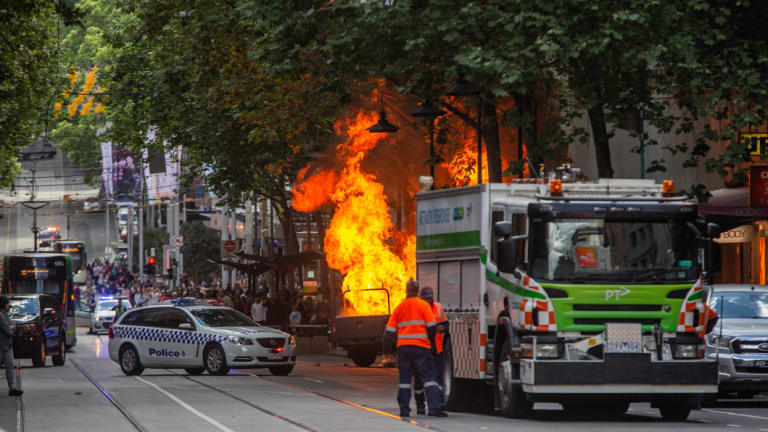 The scene in Bourke Street on Friday where Hassan Khalif Shire Ali was shot by police after setting a vehicle alight and stabbing multiple people.