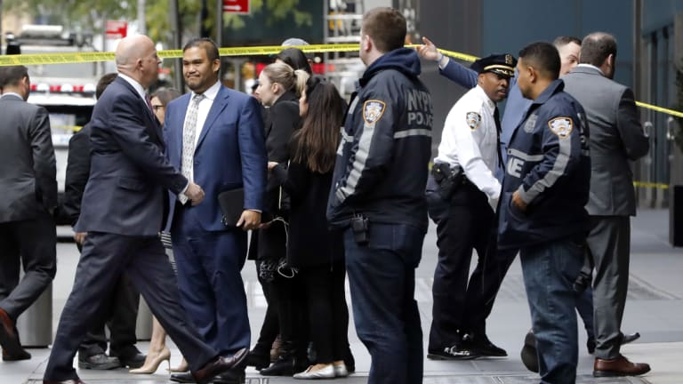 New York City Police Commissioner James P. O'Neill, left, arrives outside the Time Warner Centre, in New York, after the police bomb squad was sent to CNN's offices in New York City and the newsroom was evacuated because of a suspicious package.