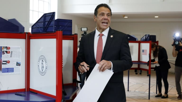 New York Governor Andrew Cuomo speaks as he marks his primary election ballot in Mount Kisco, NY.