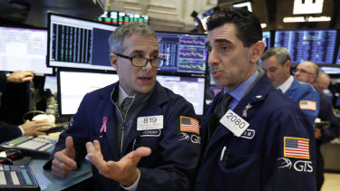 Wall Street suffered heavy losses as pessimism about the global economy hovered.