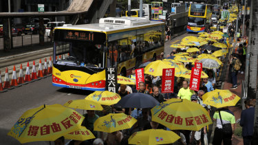 "Pro-democracy protesters carry a banner with Chinese reads ""Vindicate June 4th"" during a demonstration in Hong Kong,"