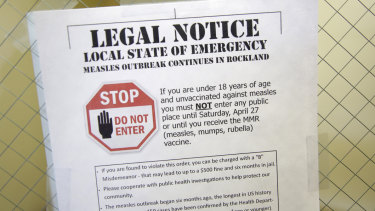 A sign explaining the local state of emergency is displayed at the Rockland County Health Department in Pomona, New York, on Wednesday.