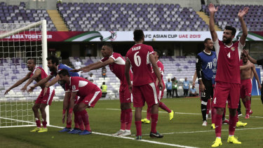 Boilover: Jordan's players celebrate after their shock 1-0 win over Australia in the Group B opener.