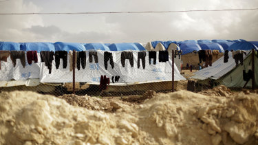 Laundry dries on a chain-link fence at Al-Hol camp, in the section where foreign families from Islamic State-held areas are housed, Hasakeh province, Syria.