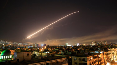 The Damascus sky lights up missile fire as the US or France or the UK launches an attack on Syria targeting different parts of the capital in April.