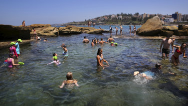 Unseasonably warm: Swimmers enjoy Coogee Beach in January, a scene which may be replicated this weekend.