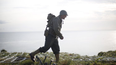 A Ranger from the US 75th Ranger Regiment, in period dress, walks on the overlook after scaling the cliffs of Pointe-du-Hoc in Cricqueville-en-Bessin, Normandy, France, on Wednesday.