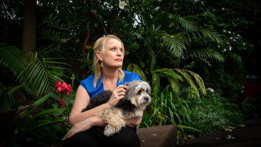 Genny Mathews and her dog Baci at her Gold Coast home.
