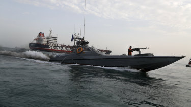 A speedboat from Iran's Revolutionary Guard moves around British-flagged oil tanker Stena Impero, which was seized on Friday by the Guard in the Iranian port of Bandar Abbas.