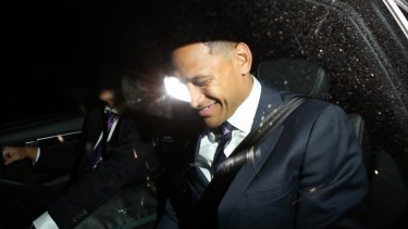 Folau laughs as he leaves Rugby Australia offices on Sunday night.