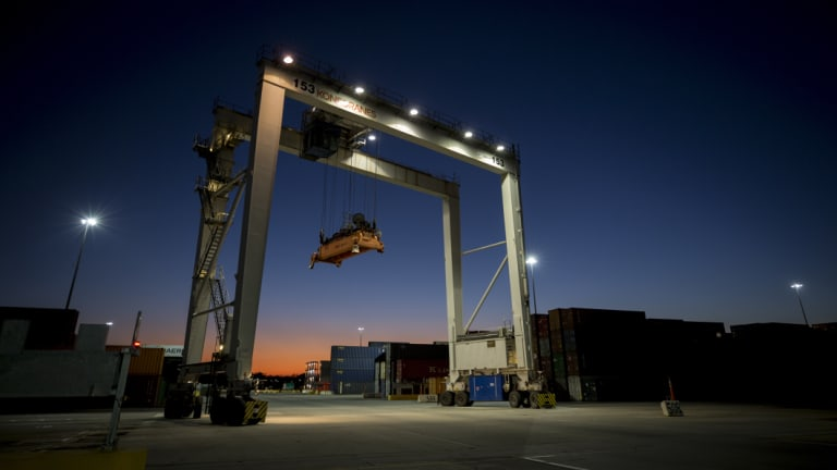 A rubber tire gantry moves into position to transfer shipping containers at the Georgia Ports Authority's Port of Savannah in Savannah, Georgia.