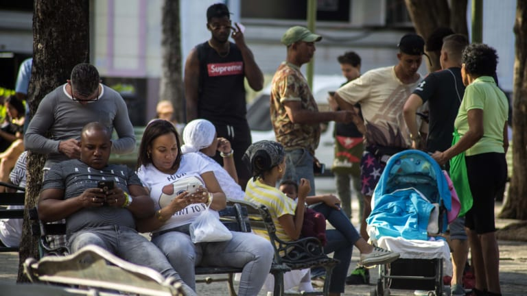People surf the internet at a government-sponsored Wi-Fi spot at a park in Havana. They will now be able to have internet on the go.