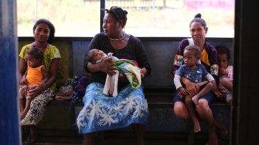 Women wait to have their children vaccinated at the Waima sub-health centre in Papua New Guinea.