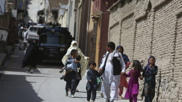 Families leaves their homes after a rocket strike in the western part of Kabul, Afghanistan, on July 24.