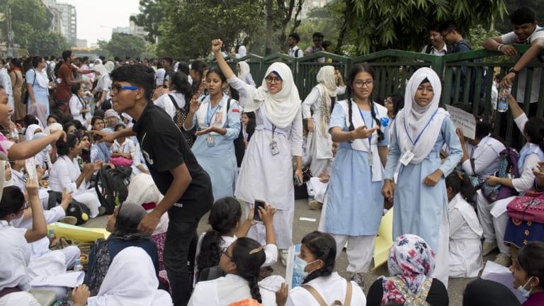 Bangladeshi students block a road during a protest in Dhaka, Bangladesh on Saturday.